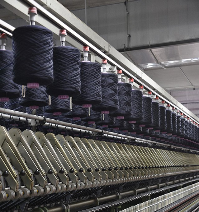 natural quality raw materials - spools in the woolen mill